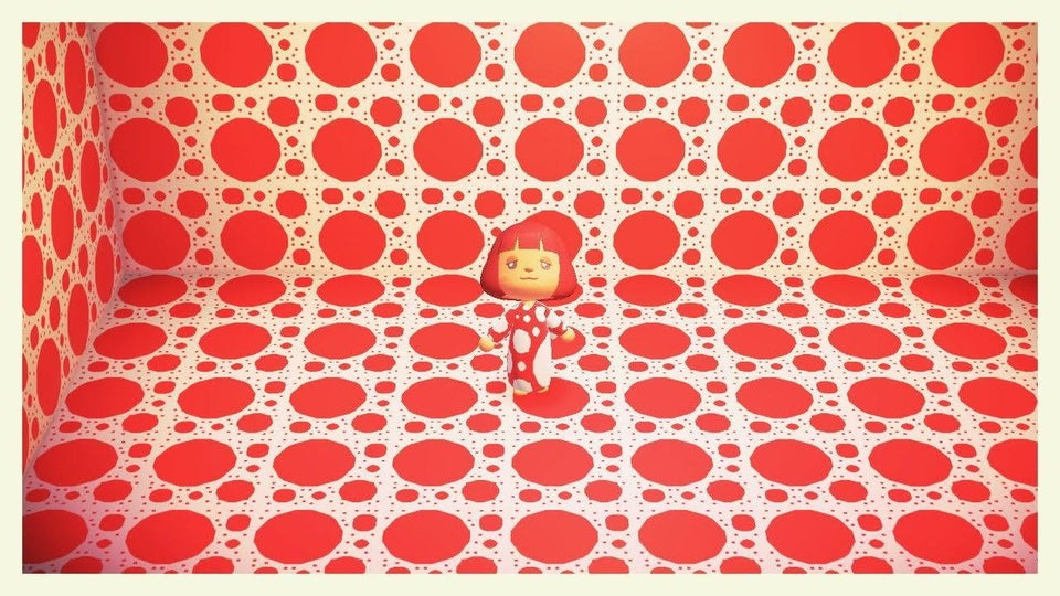 A 3D character with red bob wears white and red polka dot long gown, stands in floor to ceiling red and white polka dot room.