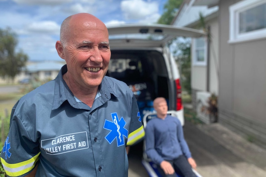 Paramedic stands in front of ambulance