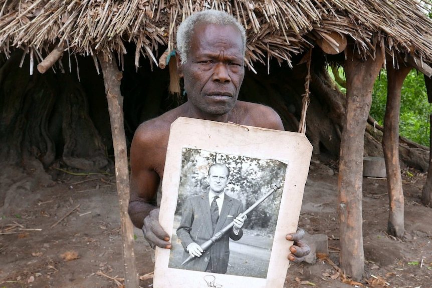Man from Tanna holds picture of Prince Philip