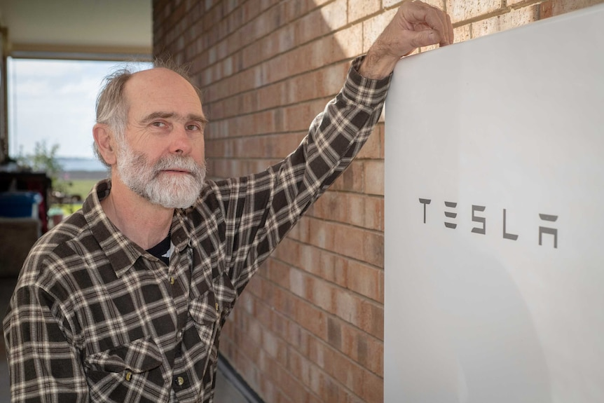 Rolf Wittwer leans on his Tesla battery.