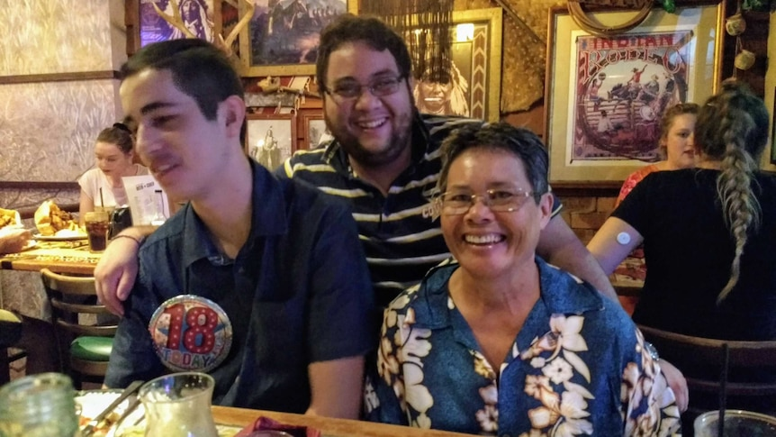 Cynthia and her two sons at a restaurant to celebrate Austin's 18th birthday.