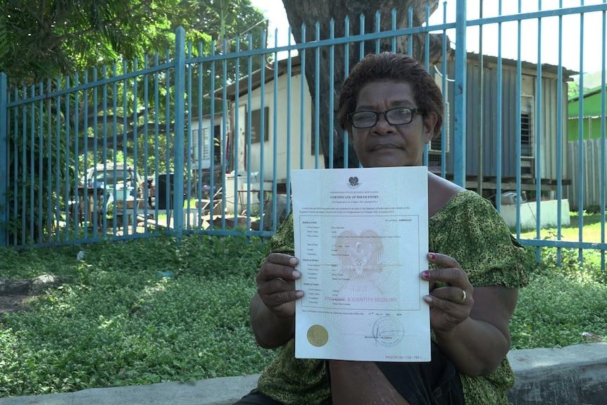 Oli Jack holds her birth certificate