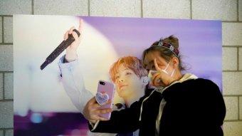 A fan of K-pop boy band BTS takes a selfie
