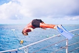 Man leaps into sea from boat