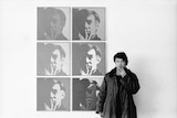 Ai Weiwei pictured with Andy Warhol's self-portraits at the Museum of Modern Art in 1987.