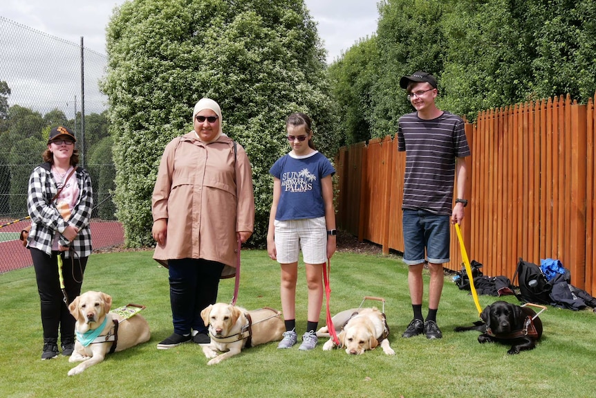 Camp participants and their trainee dogs