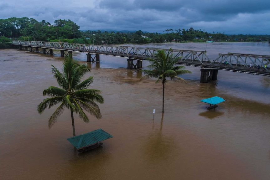 Aerial shot of a river that has burst its banks in Fiji.
