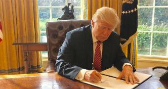 Donald Trump signs new travel ban.