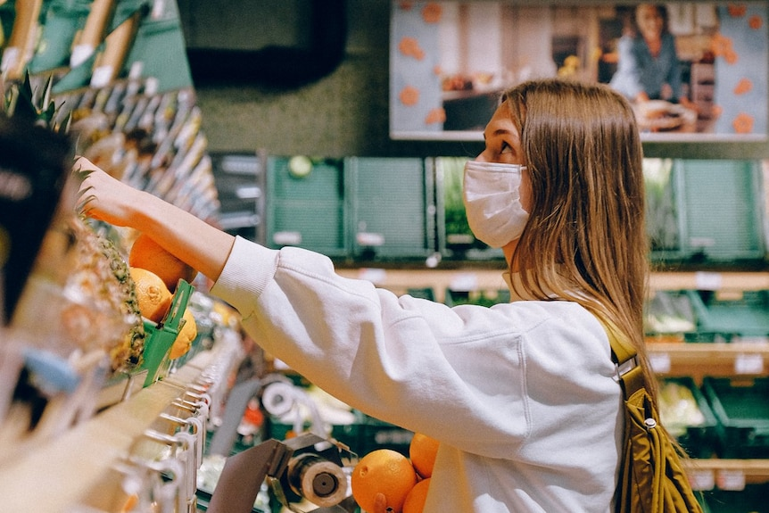 A woman wearing a mask while shopping