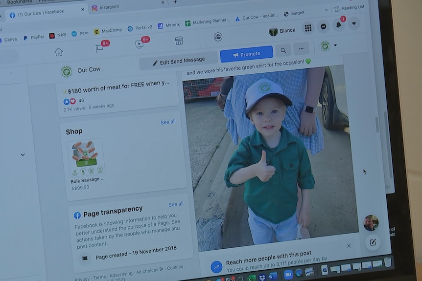 An image of a Facebook page on a laptop, featuring a photo of a young boy giving a thumbs up.