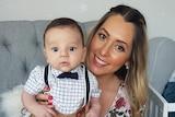 Brenda holds her baby son Oliver.