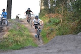 three bike riders on hell track