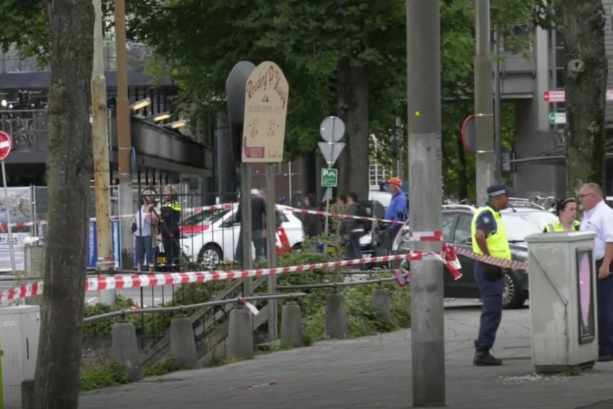 Dutch police officers stand near the scene of a stabbing attack