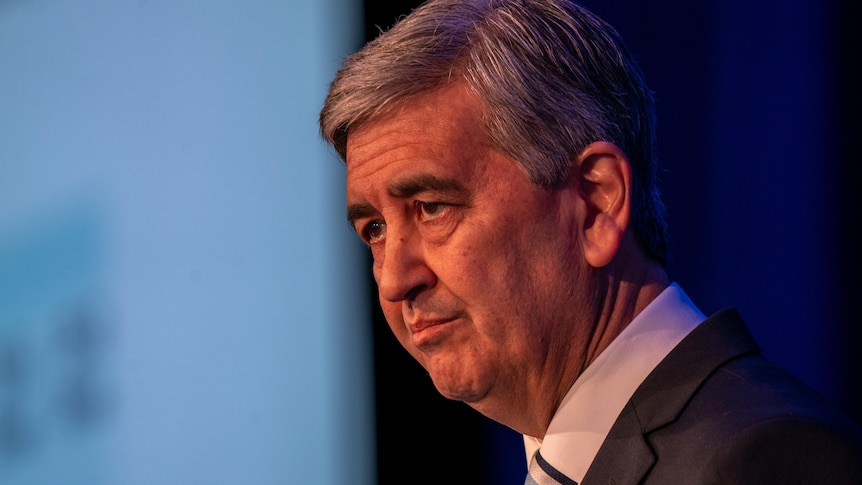Rob Lucas in profile inside the Adelaide Convention Centre handing down the 2021-22 State budget.