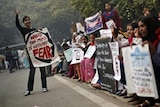 Protesters carry placards as they shout slogans during a protest to mark the first anniversary of the Delhi gang rape.