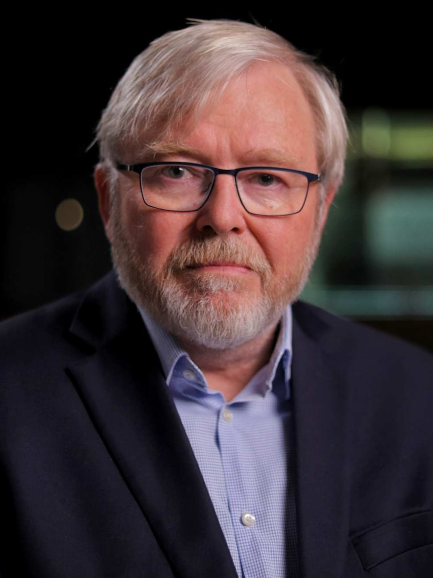 Kevin Rudd dressed in a blue shirt and jacket.