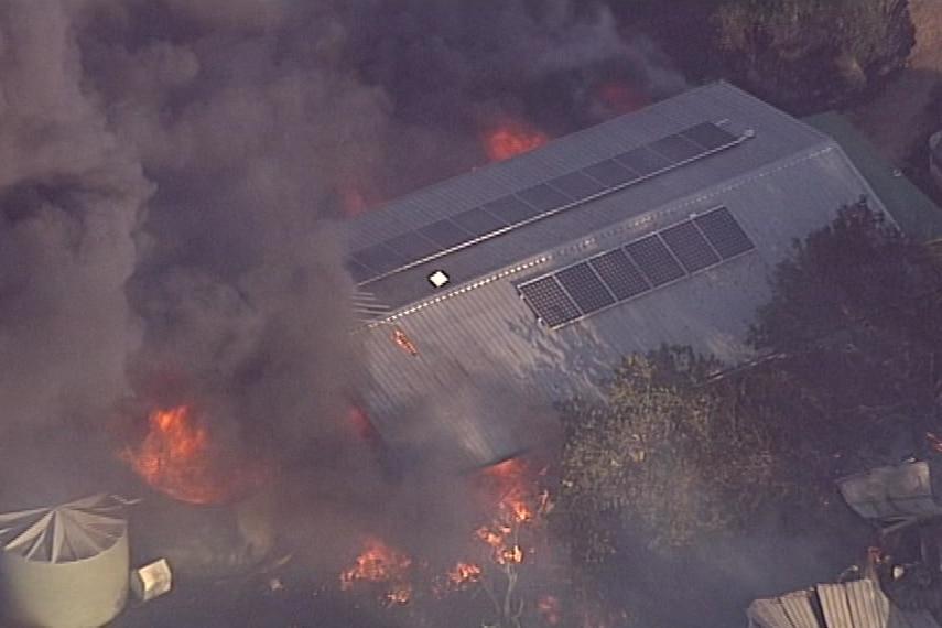 Building on fire in Toogoolawah.