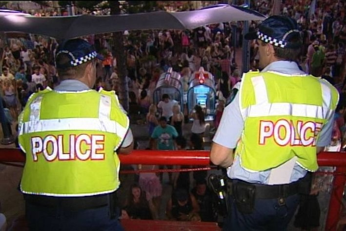 Two Qld police officers on patrol in schoolies crowds at Surfers Paradise on the Gold Coast.