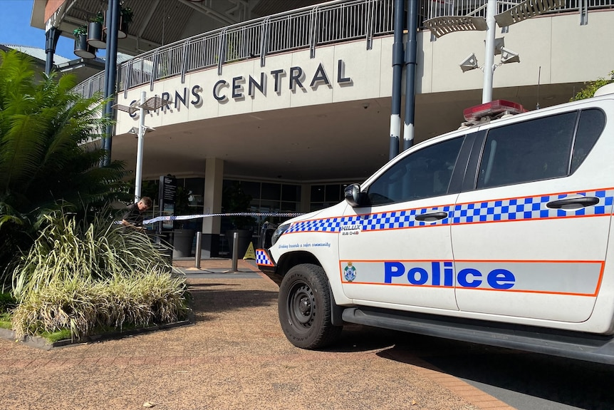 A police vehicle parked outside a shopping centre