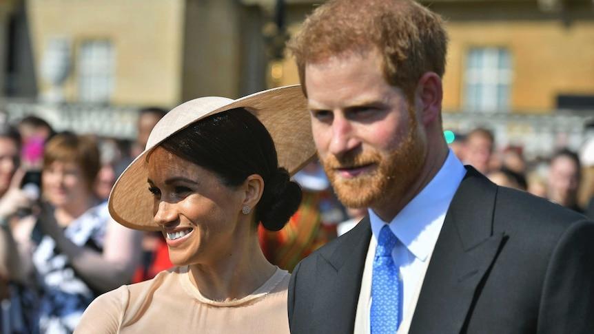 Meghan Markle walking next to Prince Harry.