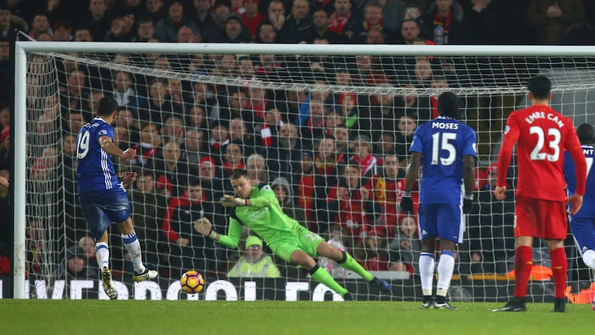 Chelsea's Diego Costa (L) has a penalty saved by Liverpool's Simon Mignolet at Anfield.