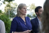 NT Government Minister Eva Lawler stands next to her colleague Chaney Paech at a press conference.