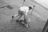 A man drags a woman into a laneway.