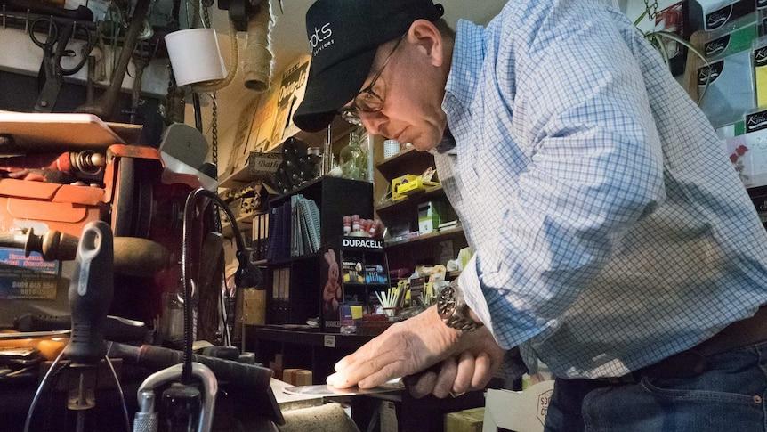 John Davis knife sharpening at his Rozelle newsagents