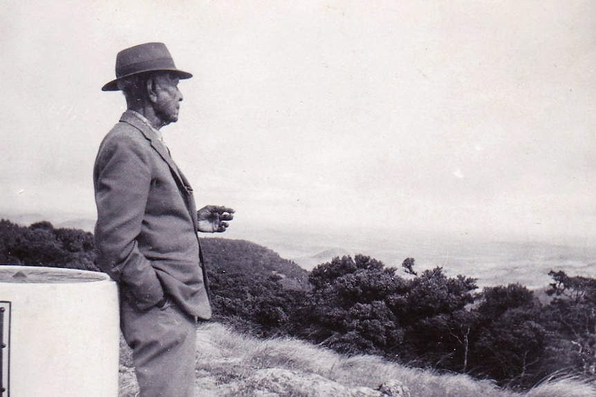 A black and white photo of Harry 'Bunda' Darlow at a lookout at the Bunya Mountains in 1971.