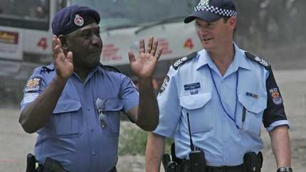 Australian Federal Police work alongside the Papua New Guinea Royal Constabulary