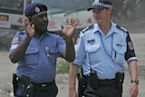 Australian Federal Police work alongside the Papua New Guinea Royal Constabulary