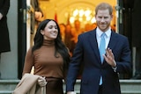 Meghan and Harry, the Duke and Duchess of Sussex walk arm in arm