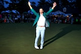 Adam Scott celebrates while wearing his green jacket after winning the 2013 Masters.