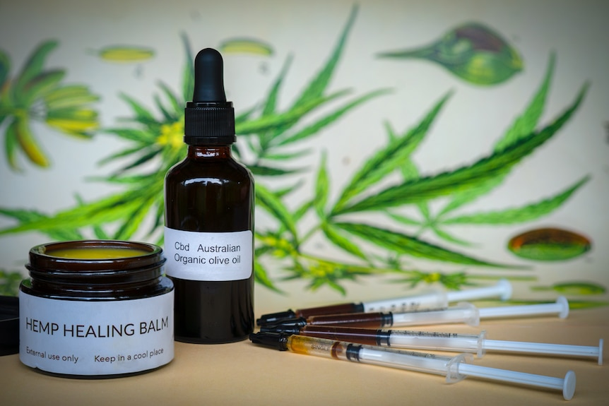 A bottle with dropper, an ointment jar and syringes labelled as containing medicinal hemp products