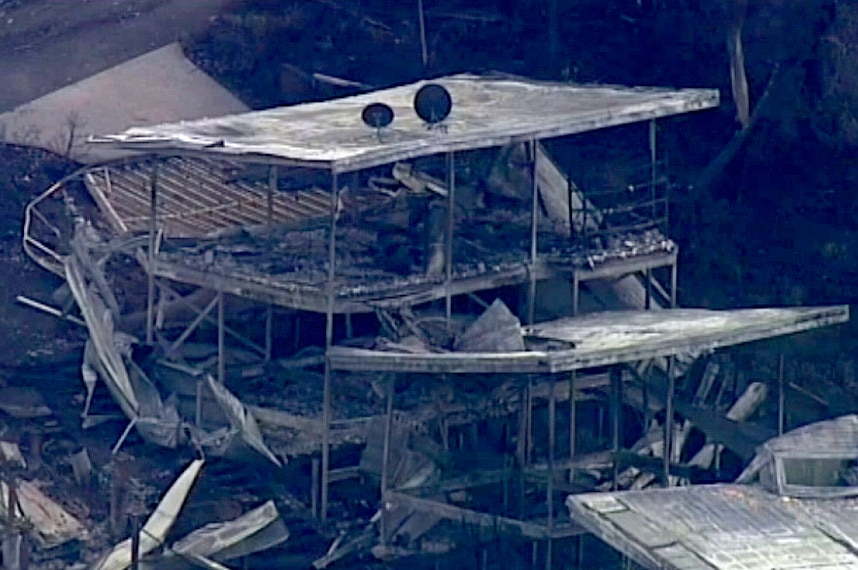 Aerial of damaged two-storey home on the Great Ocean Road