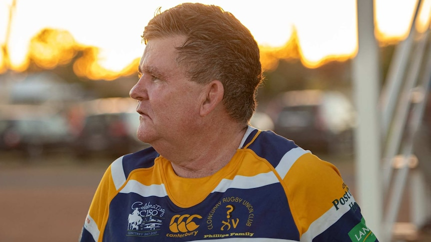 Man with rugby uniform