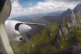 A Par Avion plane flies past Federation Peak, still from promotional video.