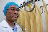 CEO of Hakubaku Australia Ryuji Nakamura stands in front of noodles being processed.