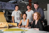 University of Newcastle students and mentor Jiri Loew with some of the group's designs for Dungog.