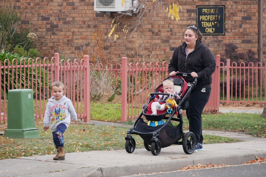 Hannah McPhee with her children walking along a footpath