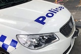 A police sign on a Victoria Police car.