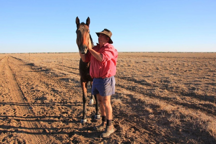 Cam Tindall, with horse 'Stromglad' at Darr River Downs