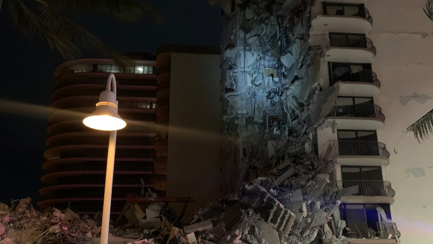 Online videos showed a large portion of the building reduced to rubble, with the apartments' interiors exposed.