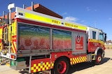 A fire truck with indigenous artwork on the side