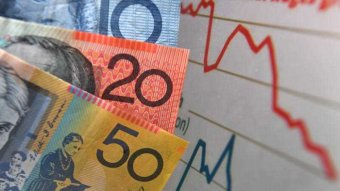 Australian currency is seen next to a wages graph