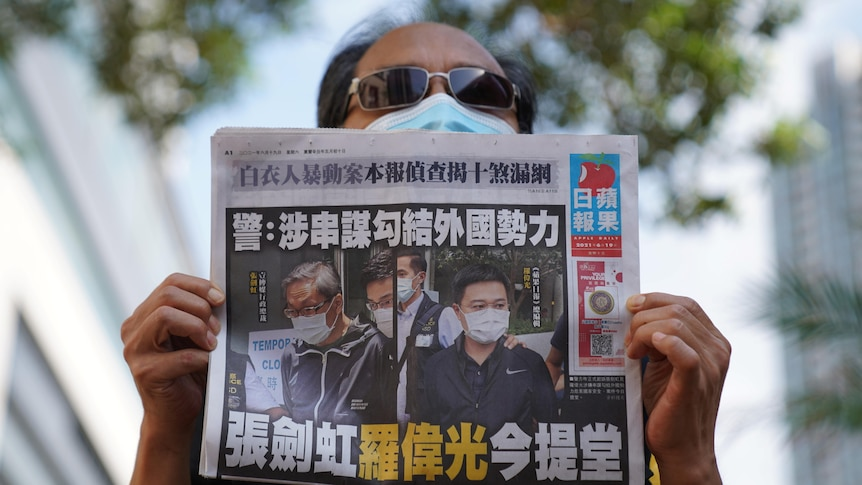 File photo of Apple Daily supporter holding a copy