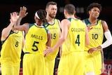 Australia's men's basketball team share high fives in Tokyo.