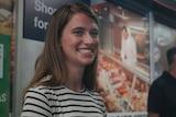 Aiya Goodrich Carttling at Rapid Creek market.