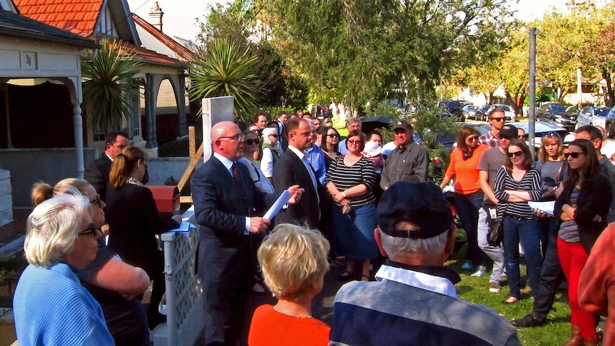 Homebuyers at an auction in Sydney