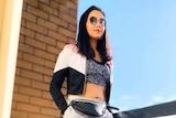 Amrita Sinha wearing athleisure on her balcony